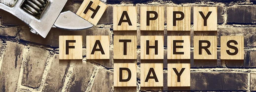 Blocks on a Brick Background that Spell Happy Father's Day