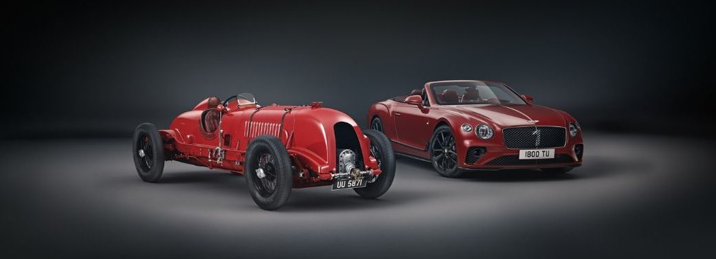Red 1929 No. 1 Bentley Blower and Red Continental GT Number I Edition on a Dark Background