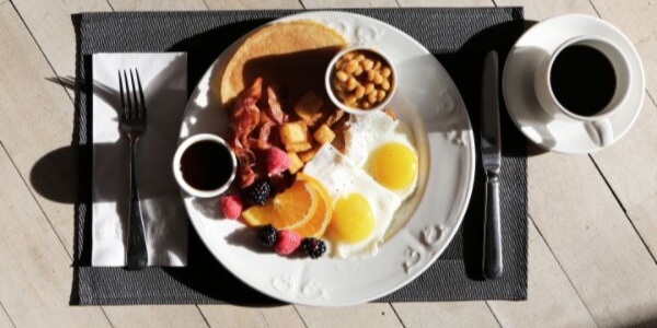 Overhead View of a Plate of Pancakes, Fruit and Eggs