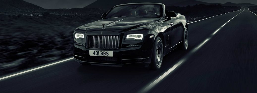2019 Rolls Royce Dawn Black Badge driving on overcast day