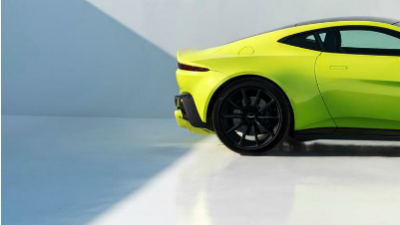 Posterior shot of a lime green 2019 Aston Martin Vantage