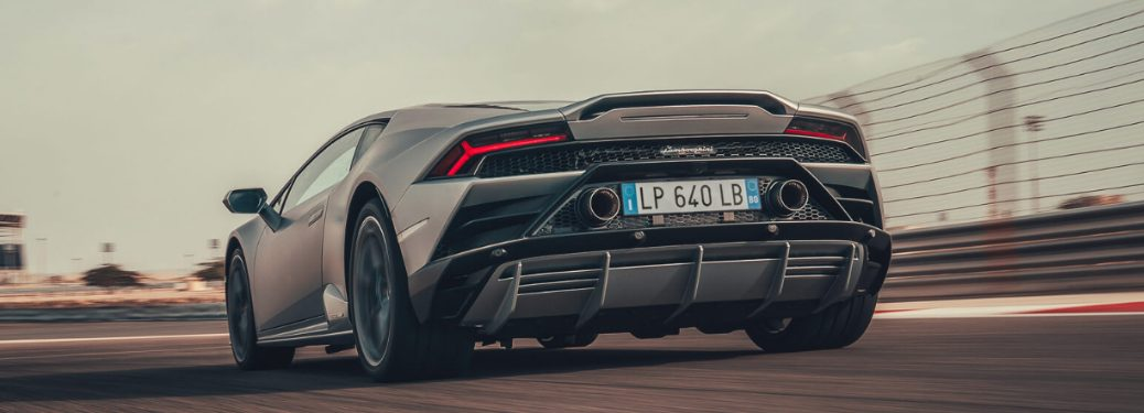 Rear view of grey 2020 Lamborghini Huracán EVO driving on a race track