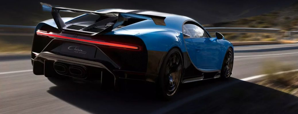 Blue and black Bugatti Chiron Pur Sport driving on a country road