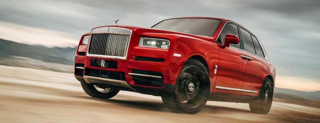 Driver's side front angle view of red 2020 Rolls-Royce Cullinan