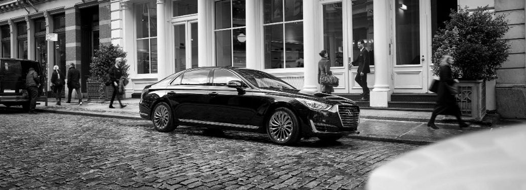 Black and White Photo of Genesis G90 on a Cobblestone Street