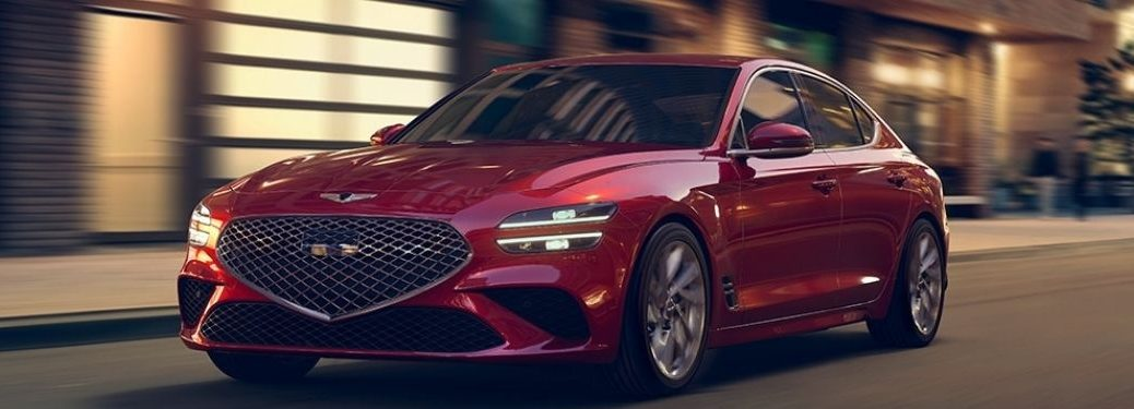 Red 2022 Genesis G70 Front Exterior on a City Street at Night