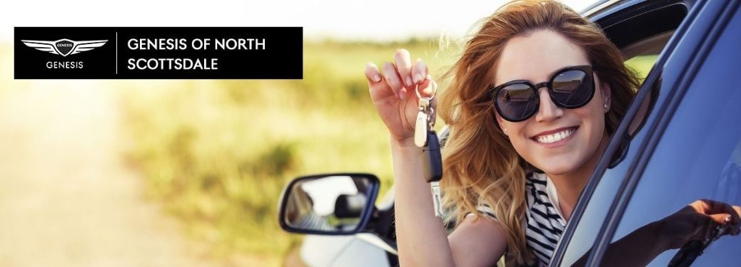 Happy Woman in New Car with Keys and Earnhardt Genesis of North Scottsdale Logo