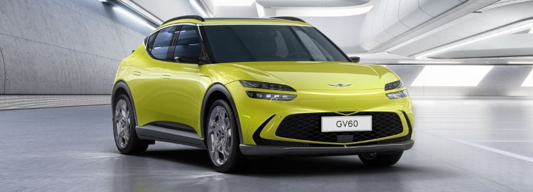 Yellow 2023 Genesis GV60 Front Exterior in a Modern Building