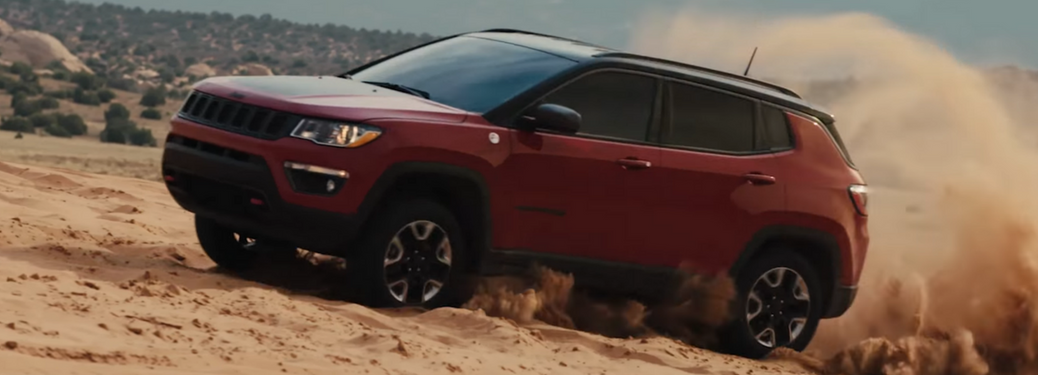 2018 Jeep Compass Trailhawk drives up a sand dune