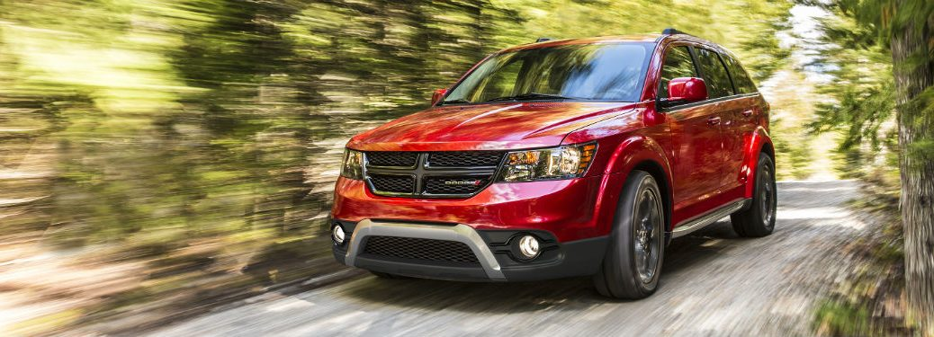 Front driver side exterior view of a red 2019 Dodge Journey