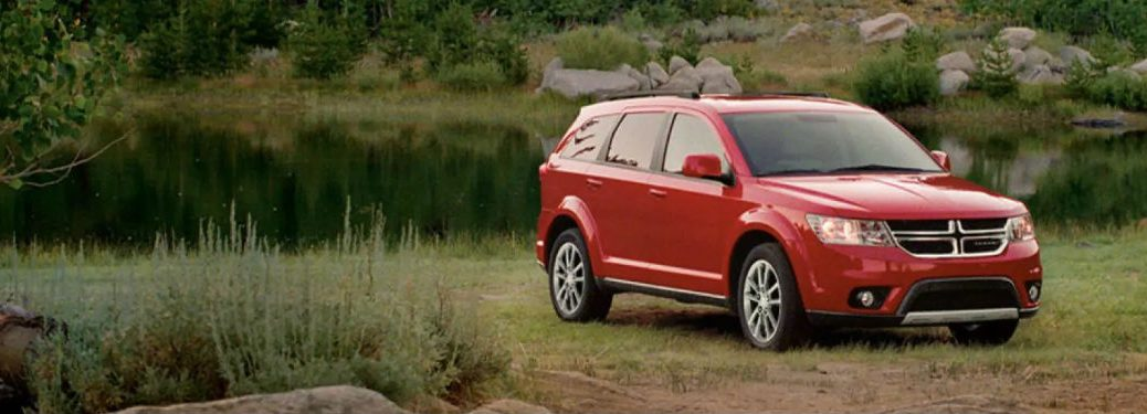 Passenger side exterior view of a red 2018 Dodge Journey