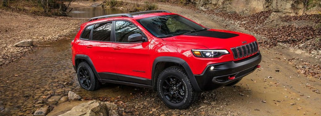 Passenger side exterior view of a red 2019 Jeep Cherokee