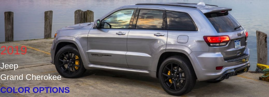 2019 Jeep Grand Cherokee Color Options, text on a driver side exterior image of a gray 2019 Jeep Grand Cherokee