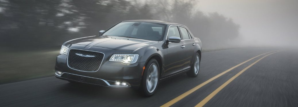 front view of chrysler 300 with headlights on
