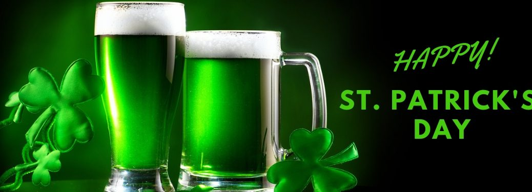 Green Beer and Shamrocks on Black Background with Green Happy! St. Patrick's Day Text