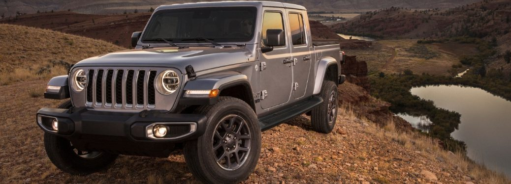 Gray 2020 Jeep Gladiator on a Trail Overlooking a Lake
