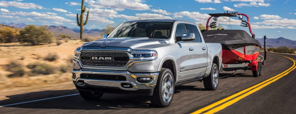 Grey 2019 Ram 1500 towing a boat