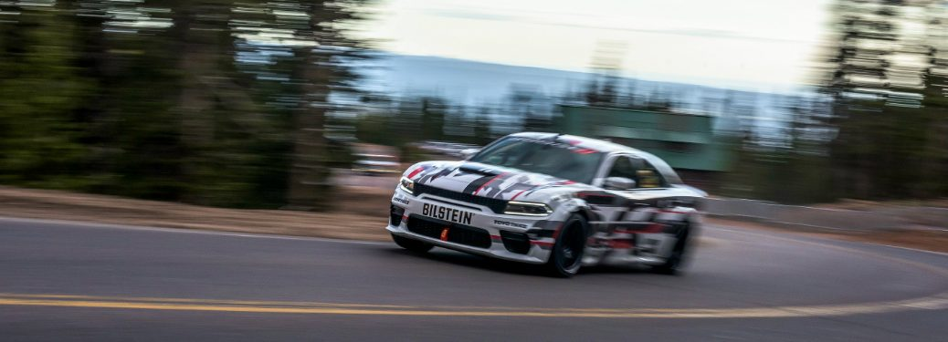Dodge Charger SRT Hellcat Widebody Concept driving by trees at the Pikes Peak International Hill Climb