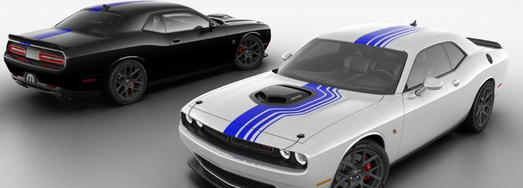 Front driver angle of a white Mopar 2019 Dodge Challenger in front and a black Mopar 2019 Dodge Challenger in back