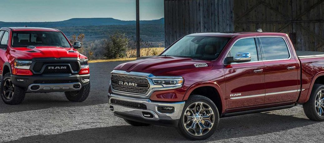 A red 2019 Ram 1500 and a maroon 2019 Ram 1500