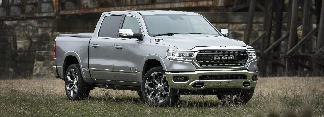 Grey 2020 Ram 1500 parked in front of a railroad bridge