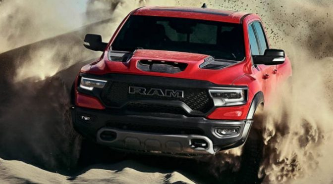 2021 Ram 1500 TRX in red driving through sand