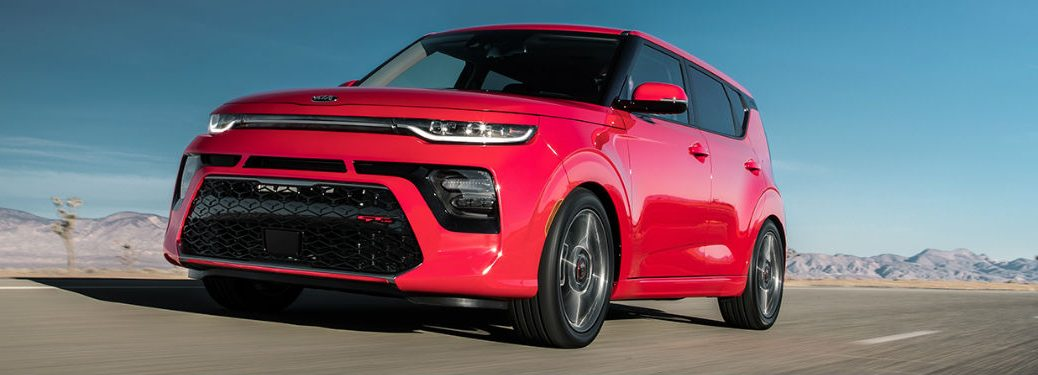 2020 Kia Soul driving down a highway road