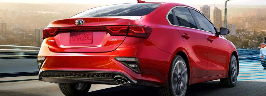 2021 Kia Forte driving down a highway road