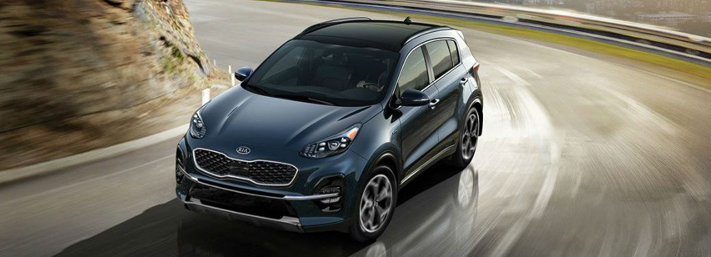2021 Kia Sportage driving on a road