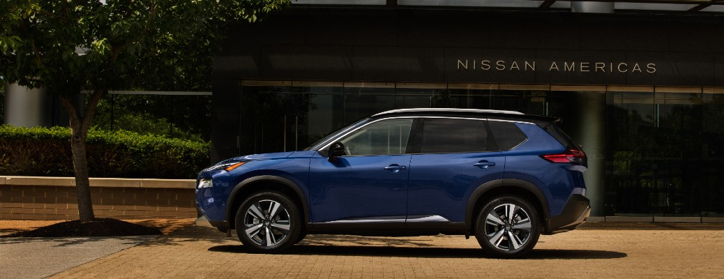 Profile view of blue 2021 Nissan Rogue