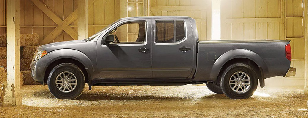 Profile view of gray 2021 Nissan Frontier