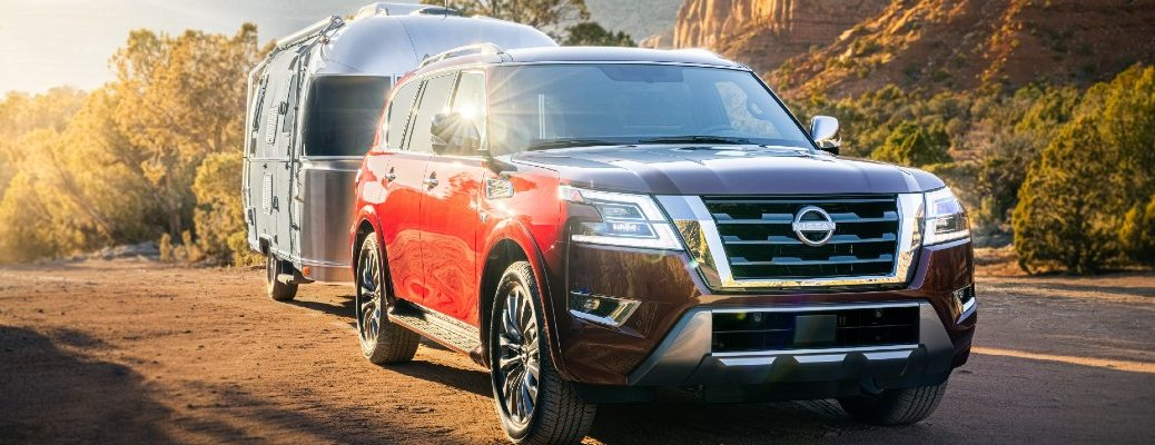 The 2022 Nissan Armada towing a mobile home.