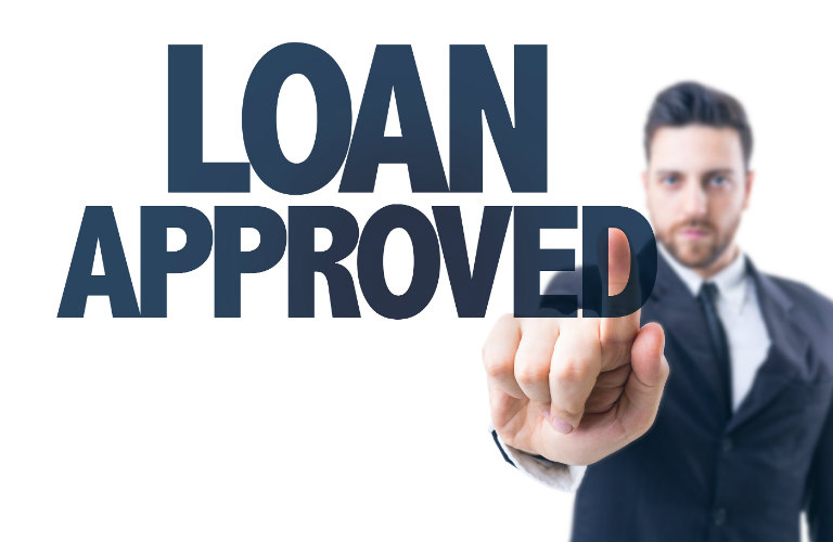 man pointing at Loan Approved text