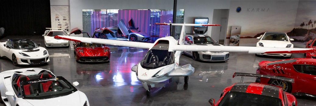 2019 ICON A5 Aircraft in Prestige Imports Showroom Surrounded by Exotic Cars