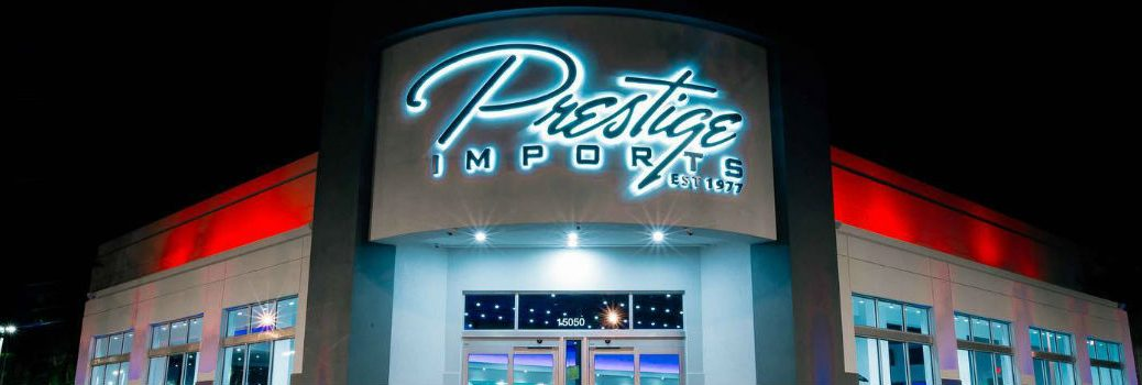 Prestige Imports Showroom Storefront at Night