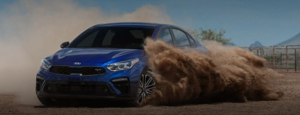 front view of the 2021 Kia Forte blowing dust