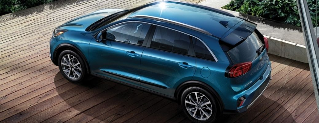top and side view of the 2021 Kia Niro parked on a wooden floor