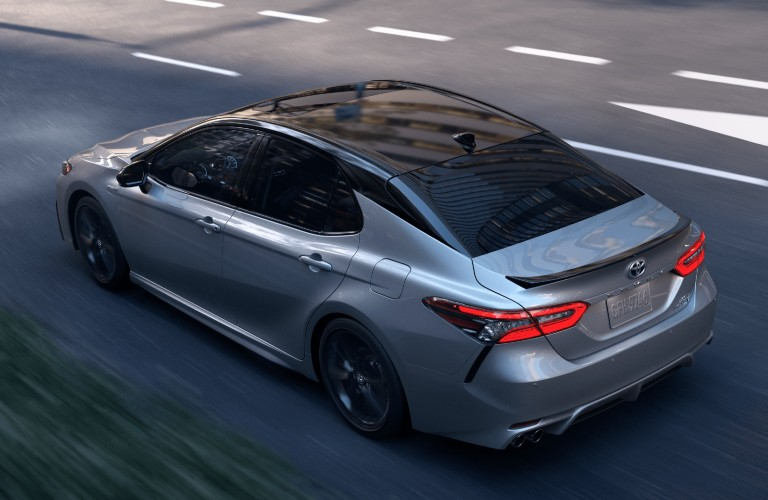 Rear driver angle of a grey 2021 Toyota Camry Hybrid