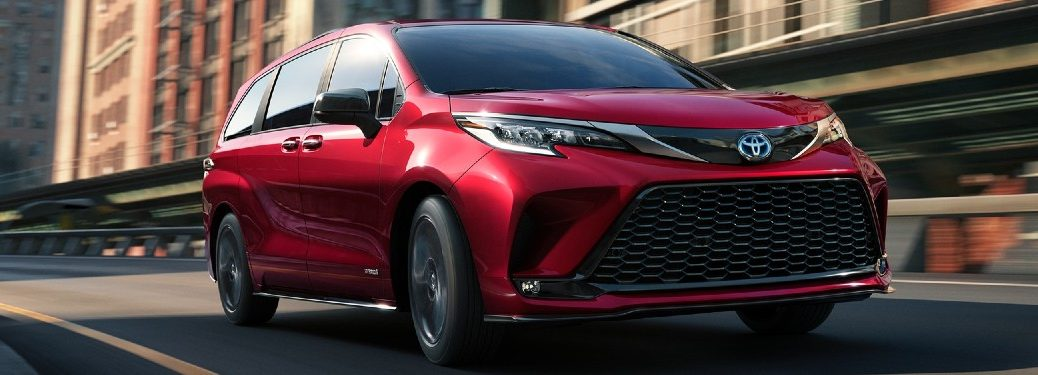 Front passenger angle of a red 2021 Toyota Sienna