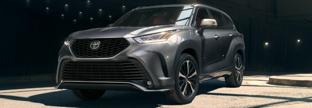 Front driver angle of a grey 2021 Toyota Highlander