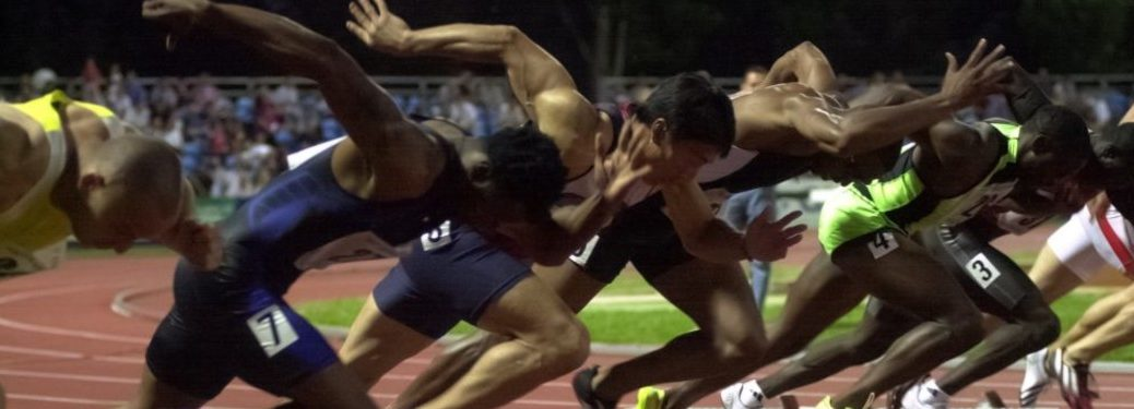 Runners sprinting on a track