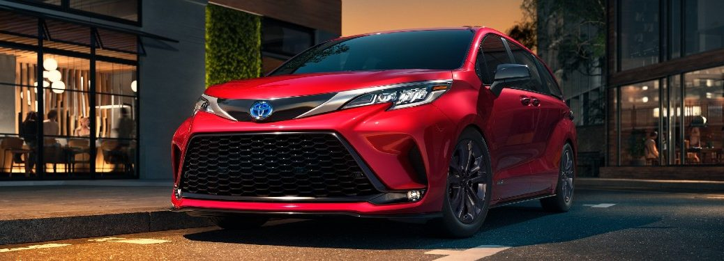 Front driver angle of a red 2021 Toyota Sienna