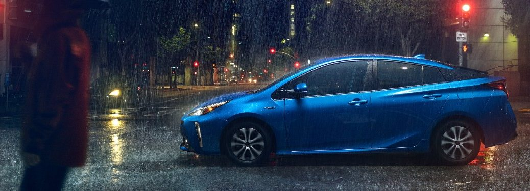 Driver angle of a blue 2021 Toyota Prius driving in rain