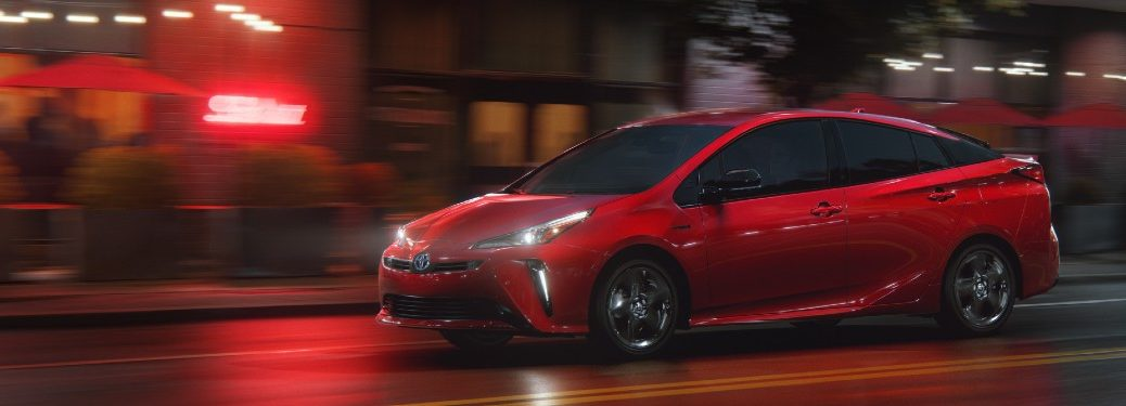 Front driver angle of a red 2021 Toyota Prius