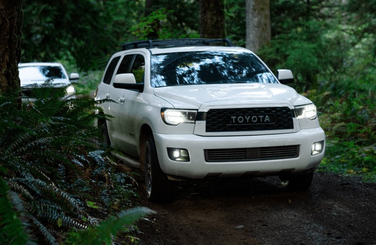 White 2021 Toyota Sequoia TRD Pro driving in a forest
