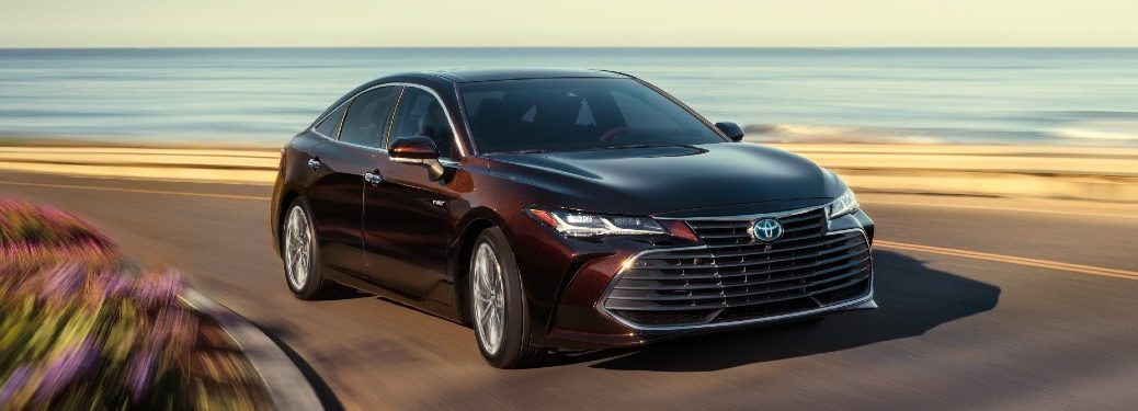 Front passenger angle of a brown 2021 Toyota Avalon