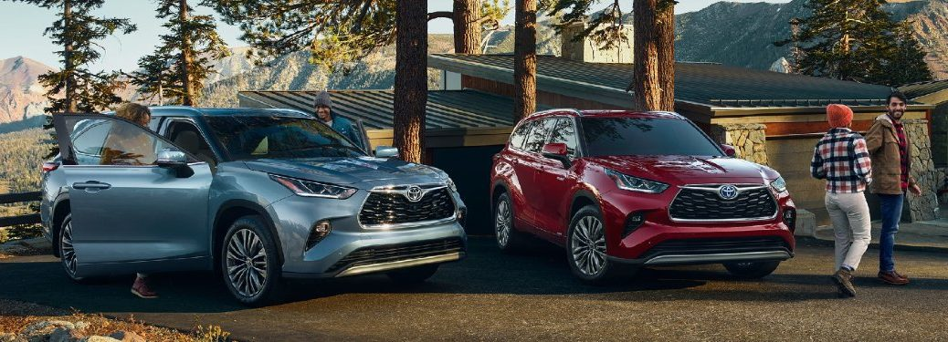 Two 2021 Toyota Highlander vehicles parked next to each other