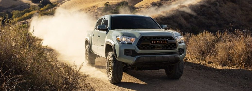 Front passenger angle of a 2022 Toyota Tacoma Trail driving off-road
