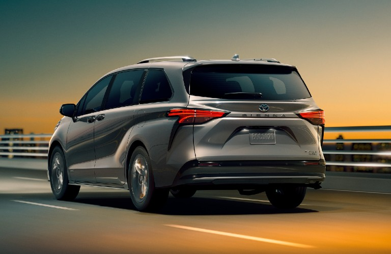 Rear passenger angle of a grey 2021 Toyota Sienna