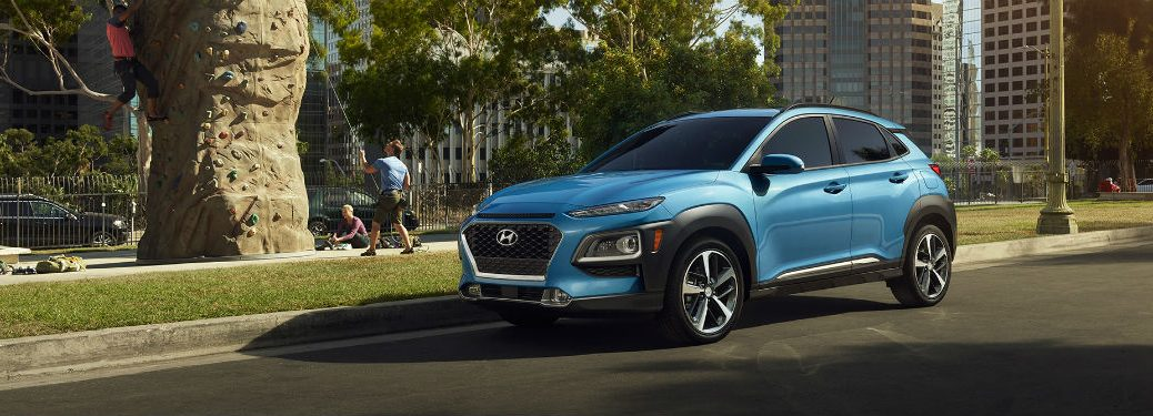 Driver side exterior view of a blue 2018 Hyundai Kona